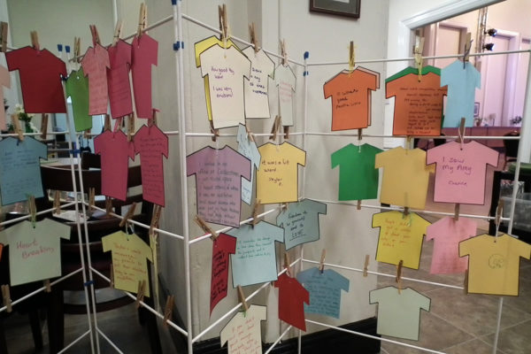 Photo of feedback written paper T-shirts and hung on a washing line