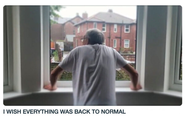 Still from DIY's Video 'I Wish Everything Was Back to Normal' showing David looking out of his window during lockdown
