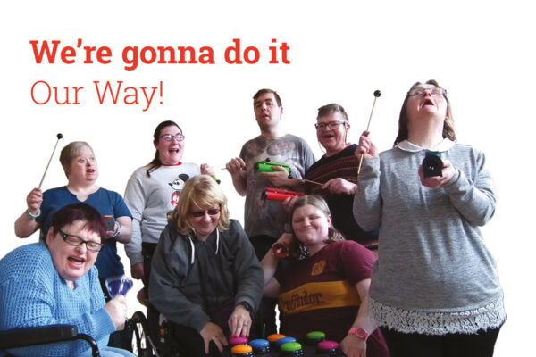 'We're gonna do it Our Way!' with a photo of DIY members making music - click to see our 3 year plan for 2019 to 2021