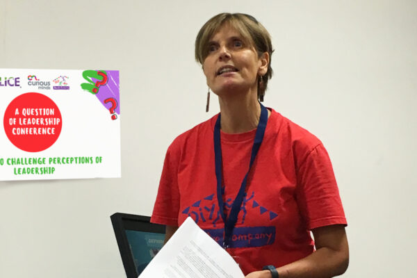 Photo of DIY's Artistic Director Sue Caudle giving a presentation on her doctorate thesis.