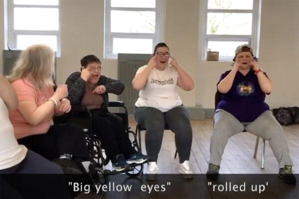 "Photo of DIY's Friday Group signing and singing ""Big yellow eyes"""
